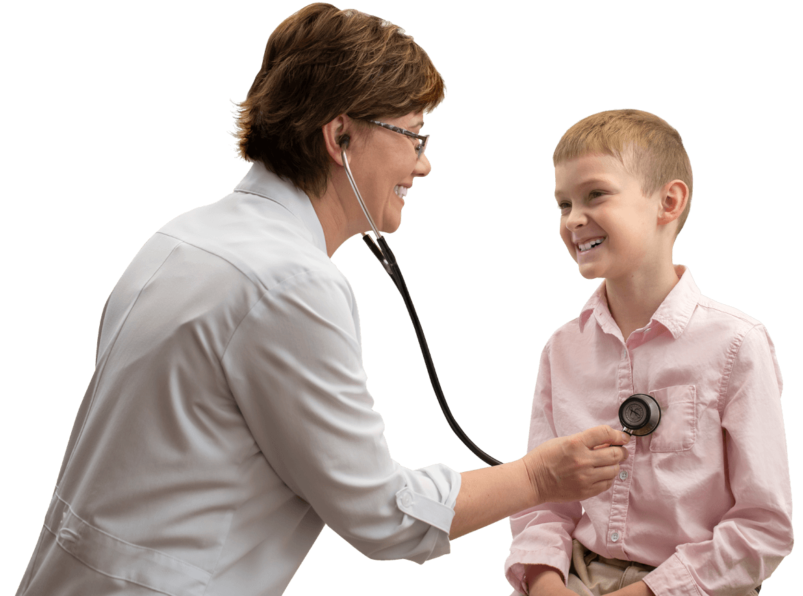 a doctor examines a boy at an appointment