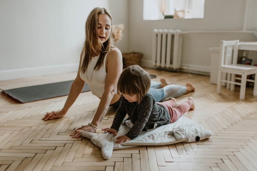 mom and child do yoga together